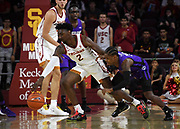 Nov 8, 2019; Los Angeles, CA, USA; Southern California Trojans guard Jonah Mathews (2) and Portland Pilots guard Chase Adams (10) bagttle for the ball in the first half at Galen Center.