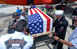 April 4, 2017 - Tampa, Florida, U.S. - The flag draped casket containing the remains of Mark Dennis is off-loaded from a Southwest plane as members of the Patriot Guard salute Tuesday, April 04, 2017 at Tampa International Airport. The remains returned to Tampa Bay eight months after the military concluded for the fourth time that they belonged to Dennis. The first time was in July, 1966, just days after Dennis, a Navy Hospital Corpsman 3rd Class, was in a helicopter shot down in Vietnam, making him the first casualty of the war from his small town south of Dayton, Ohio. (Credit Image: © Chris Urso/Tampa Bay Times via ZUMA Wire)