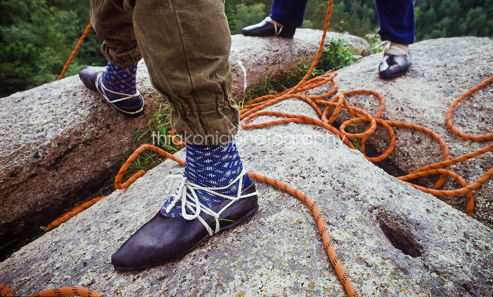 Close up of climbers make shift shoes, and orange climbing rope, Stolby Nature Reserve, Kiev, Russia, USSR