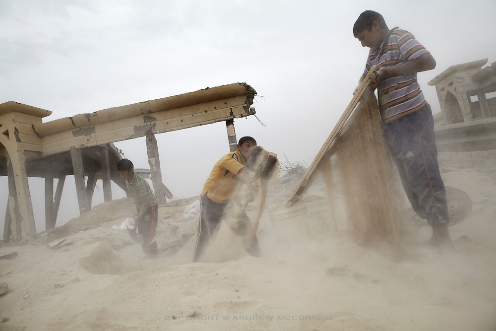 Boys sieve sand for gravel at Yasser Arafat International Airport in southern Gaza. Gravel fetches 170 Shekels (approx EUR34) per tonne and is vital for the production of concrete.