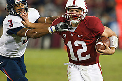 November 6, 2010; Stanford, CA, USA;  Stanford Cardinal quarterback Andrew Luck (12) is tackled by Arizona Wildcats safety Anthony Wilcox (3) during the fourth quarter at Stanford Stadium.  Stanford defeated Arizona 42-17.