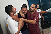 A relative of a sniper victim loose control during the funeral in the area of Gorji in Tripoli.