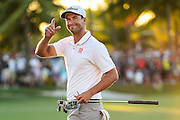 DORAL, FL - MARCH 06:  Adam Scott of Australia smiles and celebrates his one stroke victory on the 18th hole green during the final round of the World Golf Championships-Cadillac Championship at Blue Monster, Trump National Doral, on March 6, 2016 in Doral, Florida. (Photo by Chris Condon/PGA TOUR)