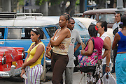 HAVANA, CUBA - OCTOBER 23, 2006: Unidentified people wait in the queue for taxi in Havana, Cuba. Public transportation in Cuba is at very low level.