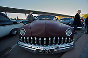 During summer from June to Septemper, every first Friday of the month is Vintage Car Cruising Night. Hundreds of classic American cars cruise around downtown Helsinki and meet at special places to have a good time, here at Kaivopuisto (Brunnsparken). Lincoln shark tooth grille from the Fifties.