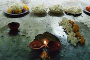 Oferrings at a shrine - a lamp and flowers. near Ratnapura.