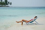 ..Woman in a caribbean beach, San Blas archipelago, Panama, Central America