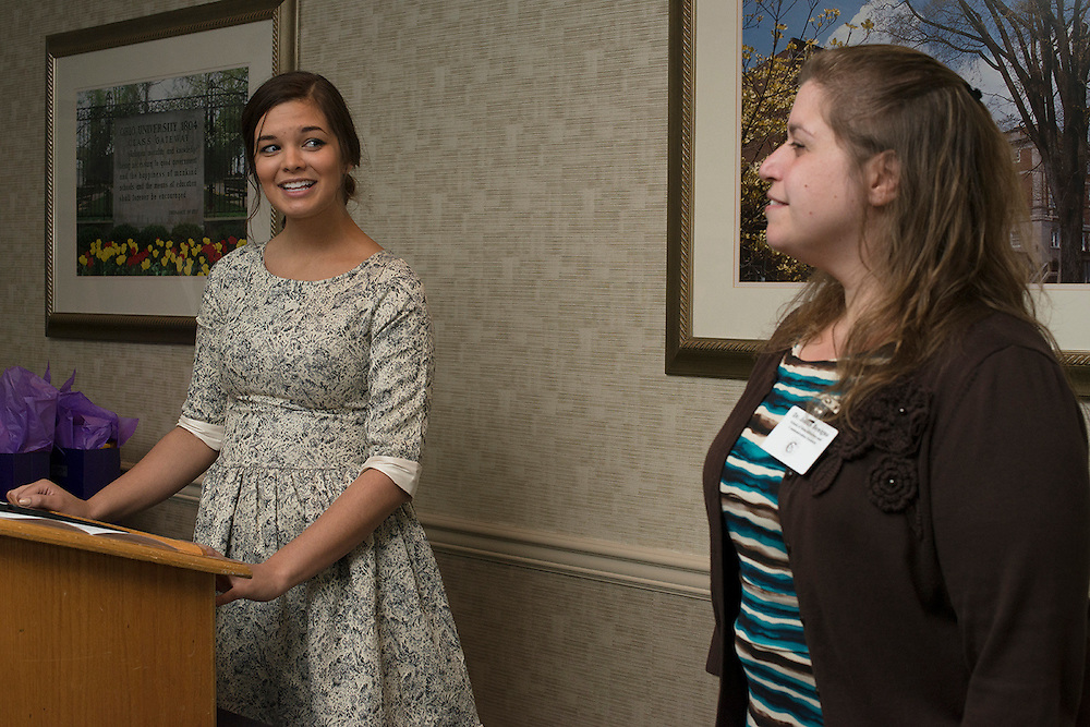 Senior Cutler Scholar Kelsey Davis presents a gift to her mentor Dr. Joann Benigno, a Associate Professor in the School of Rehabilitation and Communication Sciences during the Cutler Scholar Senior Mentor Dinner. © Ohio University / Photo by Olivia Wallace