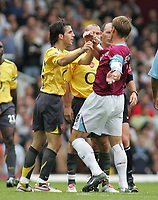 Photo: Paul Thomas.<br /> West Ham United v Arsenal. The Barclays Premiership. 24/09/2005.<br /> <br /> Arsenal's Francesc Fabregas pushes Teddy Sheringham after Teddy lashed out.