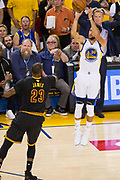 Golden State Warriors guard Stephen Curry (30) shoots a jumper over Cleveland Cavaliers forward LeBron James (23) during a jump shot attempt during Game 2 of the NBA Finals at Oracle Arena in Oakland, Calif., on June 4, 2017. (Stan Olszewski/Special to S.F. Examiner)