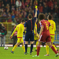BRUSSELS, BELGIUM - Sunday, November 16, 2014: Wales' Joe Allen is shown a yellow card against Belgium during the UEFA Euro 2016 Qualifying Group B game at the King Baudouin [Heysel] Stadium. (Pic by David Rawcliffe/Propaganda)