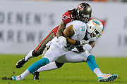 Miami Dolphins wide receiver Rishard Matthews (18) is tackled Tampa Bay Buccaneers free safety Dashon Goldson (38) during the Bucs 22-19 win at Raymond James Stadium on Nov. 11, 2013 in Tampa, Florida. <br /> <br /> &copy; 2013 Scott A. Miller