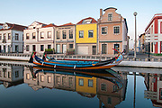 Traditional Portuguese boat (barcos moliceiros Originally used for collecting seaweed) moored in the central canal, Aveiro, Portugal at dawn