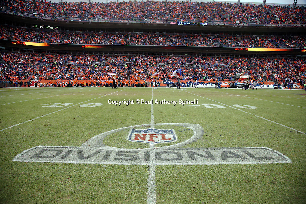The NFL Divisional playoff logo is painted on the field grass for the Denver Broncos NFL week 19 AFC Divisional Playoff football game against the Indianapolis Colts on Sunday, Jan. 11, 2015 in Denver. The Colts won the game 24-13. ©Paul Anthony Spinelli