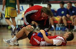 Physiotherapist Gorazd Zuzek and Boris Becirovic of Slovan at handball game RD Slovan vs RD Merkur  in 7th round of MIK First league, on October 24, 2008 in Ljubljana, Slovenia. (Photo by Vid Ponikvar / Sportal Images)