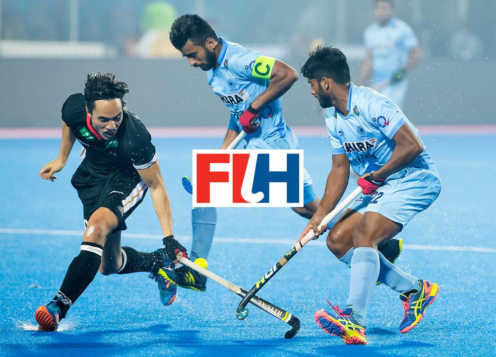 BHUBANESWAR - The Odisha Men's Hockey World League Final . Dan Nguyen (Ger) with Manpreet Singh (Ind) , Varun Kumar (Ind)  during  the match India v Germany. WORLDSPORTPICS COPYRIGHT  KOEN SUYK