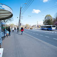 TIMISOARA, ROMANIA - APRIL 21:  People waits for the bus on one of the main streets in the city centre  on April 21, 2013 in Timisoara, Romania.  Romania has abandoned a target deadline of 2015 to switch to the single European currency and will now submit to the European Commission a programme on progress towards the adoption of the Euro, which for the first time will not have a target date. (Photo by Marco Secchi/Getty Images)