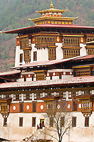 Monks walking aroung Punakha Dzong Monastery fortress, Punakha Valley, Bhutan