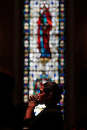 PHOTO PETER PEREIRA/4SEE<br /> <br /> A woman is seen praying at St. Patrick's church which is located near the World Trade Center.  The church became a refuge for people during the attacks.   New Yorkers deal with the 10th anniversary of September 11, 2001 in different ways.