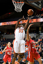 Virginia center Aisha Mohammed (33) shoots around Davidson forward Julia Paquette (35).  The Virginia Cavaliers women's basketball team defeated the Davidson Wildcats 83-68 at the John Paul Jones Arena in Charlottesville, VA on December 20, 2007.