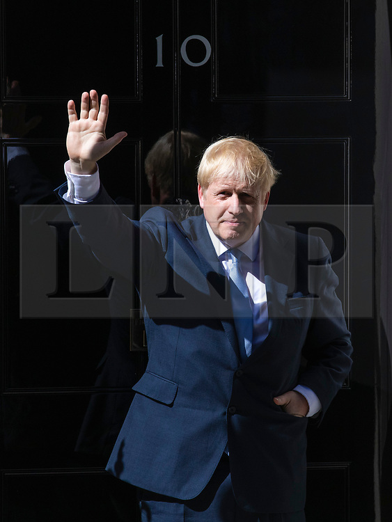 © Licensed to London News Pictures. 24/07/2019. London, UK. Prime Minister Boris Johnson waves as he enters 10 Downing Street. Photo credit: Rob Pinney/LNP