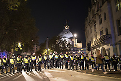 © Licensed to London News Pictures . 05/11/2016 . London , UK . Police block Abingdon Street as supporters of Parliament , many wearing Guy Fawkes masks , attend the Million Mask March bonfire night demonstration , in central London . Photo credit : Joel Goodman/LNP