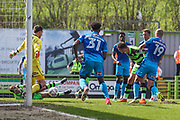 Forest Green Rovers Christian Doidge(9) shoots at goal saved by Grimsby Town goalkeeper James McKeown during the EFL Sky Bet League 2 match between Forest Green Rovers and Grimsby Town FC at the New Lawn, Forest Green, United Kingdom on 5 May 2018. Picture by Shane Healey.