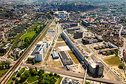 Nederland, Noord-Brabant, Eindhoven, 27-05-2013; Strijp-S, voormalige Philipsterrein, was niet toegankelijk voor het publiek, 'de verboden stad'. Het gebied, met diverse Rijksmonumenten, wordt ontwikkeld voor wonen, werken en cultuur.<br /> Links Philitefabriek met Klokgebouw (Strijp S), in het midden het Veemgebouw met daar direct naast De Hoge (Witte) Rug. Rechts in baksteen het voormalige NatLab. <br /> <br /> Strijp-S, former Philips area, was not accessible to the public, 'the forbidden city'. The area, with several national monuments, is designated for living, working and culture.<br /> Left Philitefabriek / Clock Building (Strijp S), in the middle of the Veemgebouw next to the High (White) Back.  Right in the former NatLab (brick building). <br /> <br /> luchtfoto (toeslag op standard tarieven);<br /> aerial photo (additional fee required);<br /> copyright foto/photo Siebe Swart