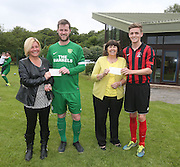 Hilltown Hotspur and DUMS captains Liam Peter and Ben Callaghan present &pound;700 cheques to Ann Kelly, represnting The British Heart Foundation and Amanada Kopel representing the Frank's Law campaign. The money comes from fines accumulated during the Dundee Saturday Morning FA season<br /> <br />  - &copy; David Young - www.davidyoungphoto.co.uk - email: davidyoungphoto@gmail.com