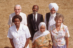 Multiracial group of elderly people standing together outdoors,