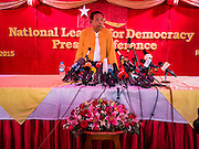 "05 NOVEMBER 2015 - YANGON, MYANMAR: A NLD official stands at the microphones before a press conference with Aung San Suu Kyi. During the press conference, which lasted 90 minutes, Aung San Suu Kyi, the leader of the National League for Democracy (NLD), said that if the NLD won the election she would serve ""above"" the President. When questioned about the Rohingya crisis in western Myanmar, a reporter called the situation ""dramatic"" and Suu Kyi replied the entire country is in a ""dramatic situation"" and the problems of the Rohingya should not be ""exaggerated."" She said the ""great majority of our people remain as poor as ever."" She also said the NLD would make a ""fuss"" if election results were ""suspicious."" Citizens of Myanmar go to the polls Sunday November 8 in what is widely viewed as the most democratic and contested election in Myanmar's history. The NLD is widely expected to win the election.   PHOTO BY JACK KURTZ"