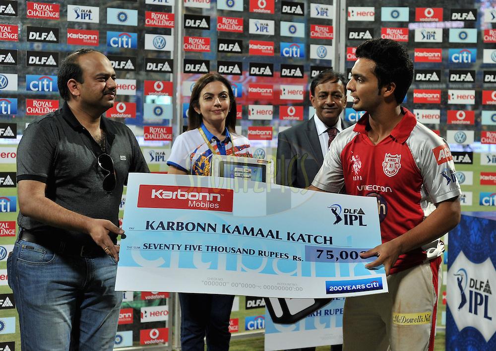 Mandeep Singh of Kings XI Punjab receives the Karbonn Kamaal Katch award during match 28 of the Indian Premier League ( IPL) 2012  between The Mumbai Indians and the Kings X1 Punjab held at the Wankhede Stadium in Mumbai on the 22nd April 2012..Photo by Pal Pillai/IPL/SPORTZPICS.