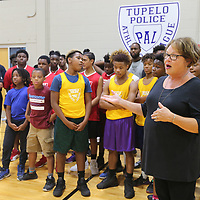 Debbie Brangenberg announces that the Tupelo Police Athletic League as this year's Grand Marshall for the annual Reed's Christmas Parade.