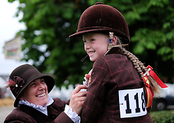 © Licensed to London News Pictures.16/07/15<br /> Harrogate, UK. <br /> <br /> HOLLY DILKS, 5, from Cumbria has some final touches down to her jacket by her mother before entering the arena on her horse Bambi on the final day of the Great Yorkshire Show.  <br /> <br /> England's premier agricultural show has seen three days of showcasing the best in British farming and celebrating the countryside.<br /> <br /> The event which attracts over 130,000 visitors each year displays the cream of the country's livestock and offers numerous displays and events giving the chance for visitors to see many different countryside activities.<br /> <br /> Photo credit : Ian Forsyth/LNP
