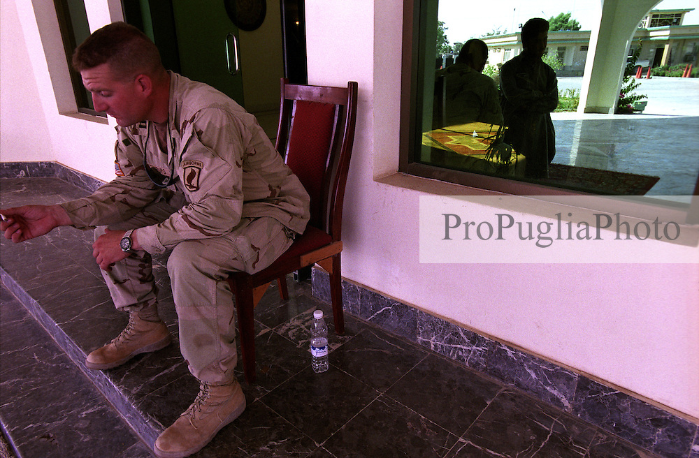 An American soldiers sits at the main entrance of the Kandahar's Governor place. Security operation are undergoing for a later planned diplomatic meeting