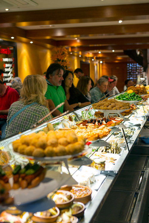 Tapas bar, Santiago de Compostela, Galicia, Spain, 2017-10-11.<br /><br />Touring the tapas and picho tavern trail in Santiago de Compostela with Karima Gallego, tour leader and director of Feast Galicia food tours.