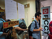 "26 JUNE 2015 - BANGKOK, THAILAND:  People file out of the Foreign Correspondents' Club of Thailand after Thai police cancelled the release of a Human Rights Watch (HRW) report, ""Persecuting 'Evil Way' Religion: Abuses against Montagnards in Vietnam"", at the Foreign Correspondents' Club of Thailand (FCCT) in Bangkok Friday morning. The report made no mention of the human rights situation in Thailand. The Thai Ministry of Foreign Affairs (MFA) contacted HRW Thursday afternoon and asked them to cancel the program because it was a ""sensitive"" matter that could impact on Thai-Vietnam relations. HRW told the MFA that they would go ahead with the report's release. Friday morning, before the report was scheduled to be released, Thai police officers arrived at the FCCT and cancelled the event. Phil Robertson, deputy director of Human Rights Watch's Asia division, said, ""By stepping in to defend a neighboring state's human rights violations against a group of its people and interrupting a scheduled press conference, Thailand's military junta is violating freedom of assembly and demonstrating its contempt for freedom of the press.""      PHOTO BY JACK KURTZ"