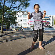 Nederland Rotterdam 18-09-2009 20090918 Foto: David Rozing  Kinderen spelen buiten op pleintje in achterstandswijk Crooswijk, op de achtergonrd woningen. Deprived area / projects This area is on a list with projects which need help of the government because of degradation in the area etc project problem. Neighboorhood neighboorhoods district city problems                                                   .Foto: David Rozing