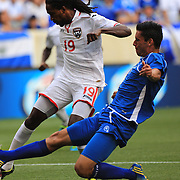 Keon Daniel, Trinidad and Tobago, shoots past Steve Purdy, El Salvador, to score his sides first goal during the El Salvador Vs Trinidad and Tobago CONCACAF Gold Cup group B football match at Red Bull Arena, Harrison, New Jersey. USA. 8th July 2013. Photo Tim Clayton