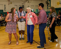 Taylor Avery, Pan Pradachith, Edith Cooper and Mohammad Abu-Zaid dance the night away at the Laconia Community Center during Laconia High School's Hawaiian themed Senior / Senior prom Thursday evening.  (Karen Bobotas/for the Laconia Daily Sun)
