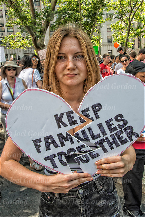 Protester holding up sign &quot;Keep Families Together&quot;  @ Foley Square and then across the Brooklyn Bridge before rallying in Cadman Plaza.<br /> <br /> Thousands are gathering in Manhattan &mdash; in one of about 750 planned marches around the country &mdash; to protest the Trump administration&rsquo;s rescinded policy of separating immigrant children and parents suspected of illegally crossing the U.S. border. <br /> <br /> Demand an end to President Trump&rsquo;s cruel &ldquo;zero tolerance&rdquo; policy and to support immigrant families in New York and across the country.<br /> <br /> Every day, this administration threatens the very future of our communities. The conditions these children are being subjected to is deplorable and un-American.