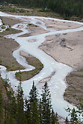 The Robson River braids paths through its gravel bed in the Valley of a Thousand Falls, Mount Robson Provincial Park, British Columbia, Canada. This is part of the Canadian Rocky Mountain Parks World Heritage Site declared by UNESCO in 1984.