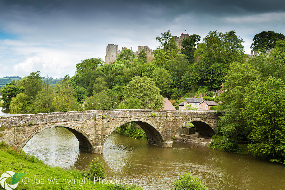 Dinham Bridge, crossing the River Teme in Ludlow, Shropshire. Behind is Ludlow Castle, a formidable fortress founded in the late 11th century.