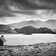 An oft-photographed scene, the old fishing bothy by Loch Stack. A simple wee structure typical of Sutherland and looking very much at home by the banks of the remote looking loch and landscape beyond.