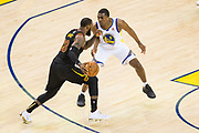 Golden State Warriors forward Kevon Looney (5) defends Cleveland Cavaliers forward LeBron James (23) during Game 1 of the NBA Finals at Oracle Arena in Oakland, Calif., on May 31, 2018. (Stan Olszewski/Special to S.F. Examiner)