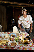 José Angel Galaviz Carrillo, a rancher of Pima heritage living in the Sierra Mountains near Maycoba, Sonora, Mexico, with one day's worth of food. (From the book What I Eat: Around the World in 80 Diets.)  The caloric value of his day's worth of food in August was 2900 kcals. He is 33 years of age; 5 feet, 8 inches tall; and 167 pounds. MODEL RELEASED.