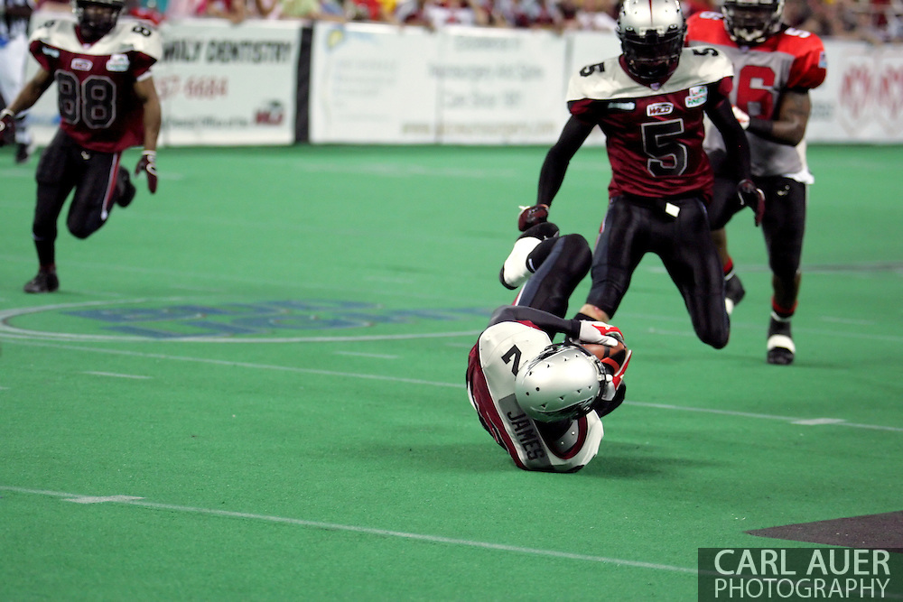 6-28-2007: Anchorage, AK - Alaska's Demarcus Morris (3) recovers the ball he just fumbled in the Alaska Wild 47 to 53 loss to the CenTex Barracudas at the Sullivan Arena...
