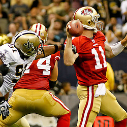 August 12, 2011; New Orleans, LA, USA; New Orleans Saints defensive end Will Smith (91) reaches for the arm of San Francisco 49ers quarterback Alex Smith (11) during the first half of a preseason game at the Louisiana Superdome. Mandatory Credit: Derick E. Hingle