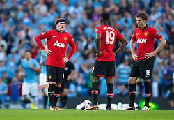 22.09.2013, Etihad Stadion, Manchester, ENG, Premier League, Manchester City vs Manchester United, 5. Runde, im Bild Manchester United's Wayne Rooney looks dejected as Manchester City score the third goal during the English Premier League 5th round match between Manchester City and Manchester United at the Etihad Stadium, Manchester, Great Britain on 2013/09/22. EXPA Pictures © 2013, PhotoCredit: EXPA/ Propagandaphoto/ David Rawcliffe<br /> <br /> ***** ATTENTION - OUT OF ENG, GBR, UK *****