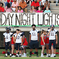 "A sign reading ""Friday Night Lights"" hangs on the Baldwyn sidelines during Friday night's Skunk Bowl game at Booneville."